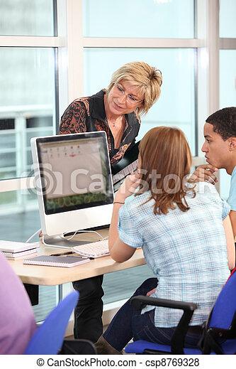 Professor with students - csp8769328