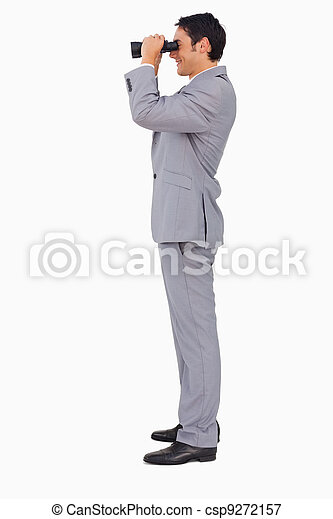 Profile of a businessman using binoculars  - csp9272157
