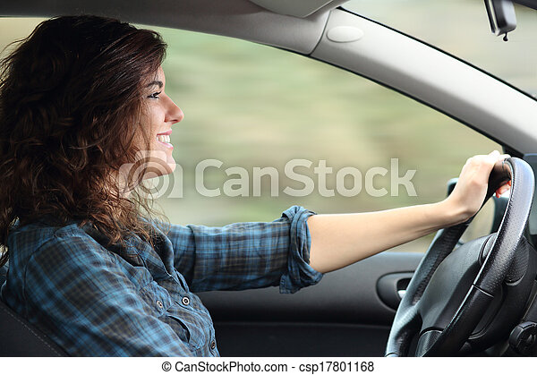 Profile of a happy woman driving a car - csp17801168
