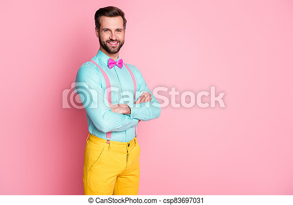 Profile photo of handsome guy trend clothes red carpet celebrity arms crossed photographing posing wear shirt suspenders bow tie yellow pants isolated pastel pink color background - csp83697031