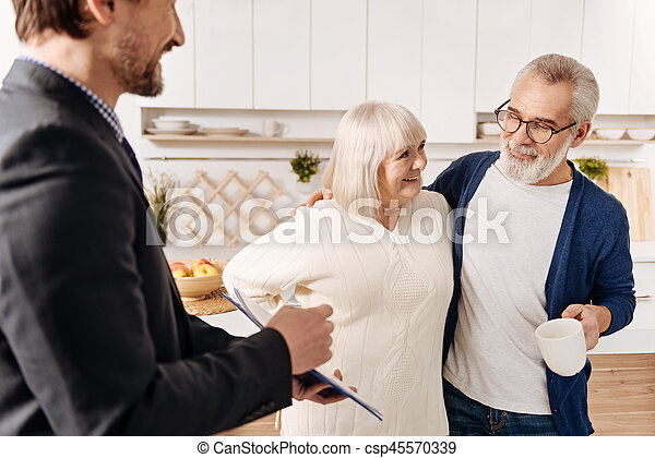 Profound legal advisor meeting with senior couple of clients - csp45570339