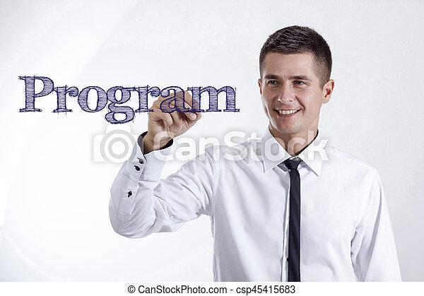 Program - Young smiling businessman writing on transparent surface - csp45415683