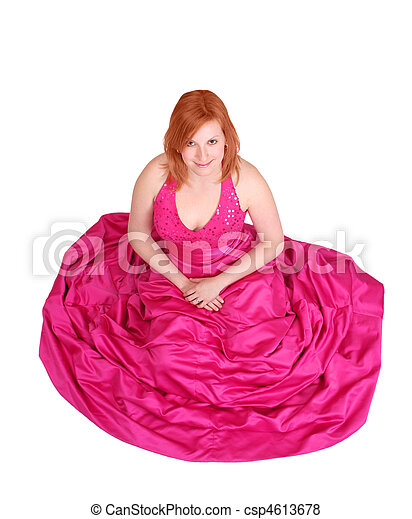 5c7c370e0a3 Prom girl. Redhead girl wearing a pink prom dress isolated over white.