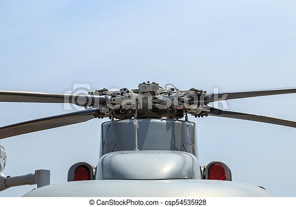 Propeller of grey helicopter of Thai army on blue sky