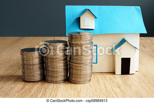 Property value. Model of house and coins. - csp58984913