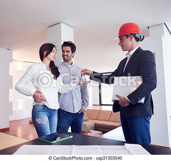 Una pareja comprando una nueva casa con un agente inmobiliario - csp31303540