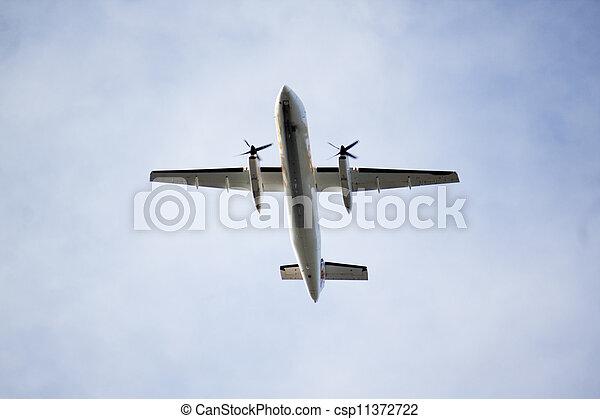 propller plane overhead on final approach - csp11372722
