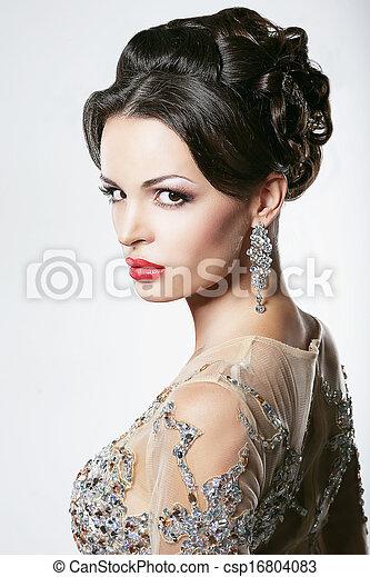 Prosperity. Luxury. Glamorous Showy Woman with Diamond Earrings - csp16804083