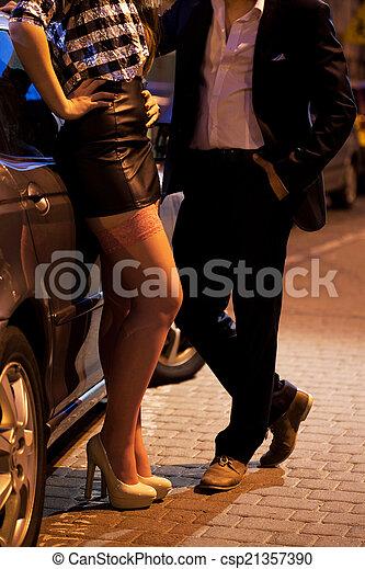 Prostitute talking to client - csp21357390