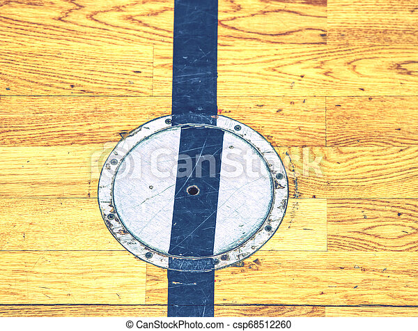 Protection circle cap of a electrical outlet in wooden floor - csp68512260
