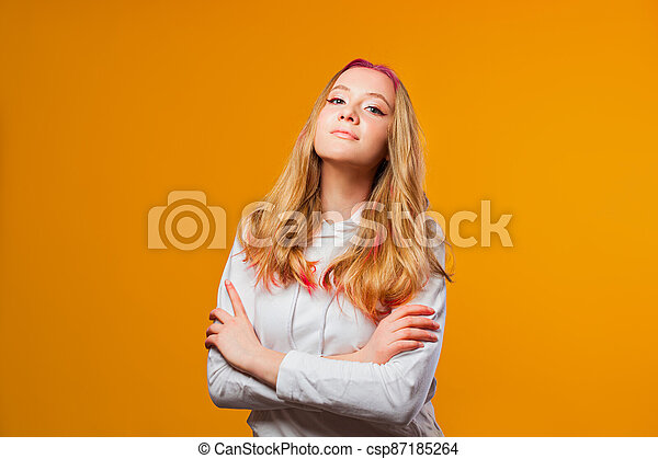 Proud young woman holding her head high - csp87185264