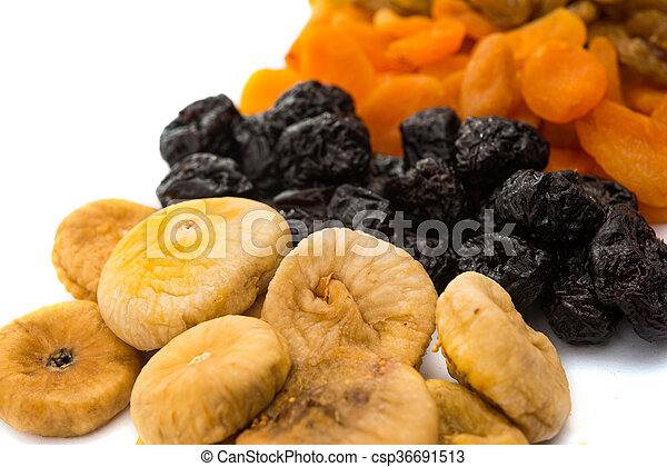 prunes, figs, dried apricots isolated on white background - csp36691513
