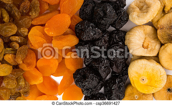 prunes, figs, dried apricots isolated on white background - csp36691427