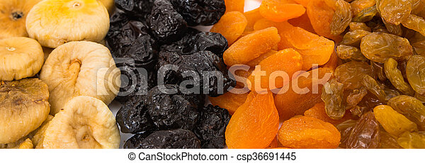 prunes, figs, dried apricots isolated on white background - csp36691445