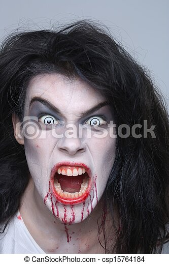 Psychotic Bleeding Woman in a Horror Themed Image - csp15764184