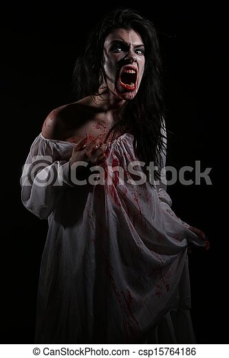 Psychotic Bleeding Woman in a Horror Themed Image - csp15764186