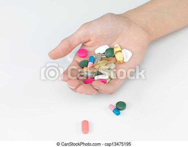 Un puñado de pastillas - csp13475195