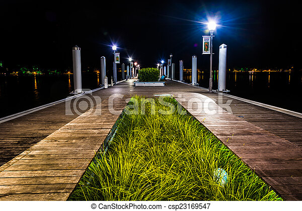 Public dock at night, in West Palm Beach, Florida. - csp23169547