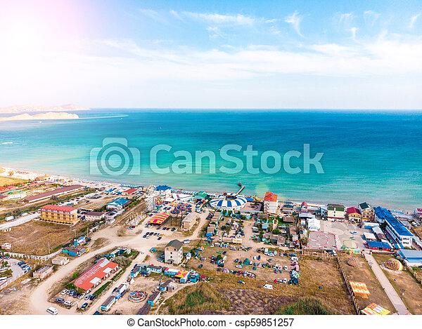 Vista aérea de un pueblo turístico en la costa. - csp59851257