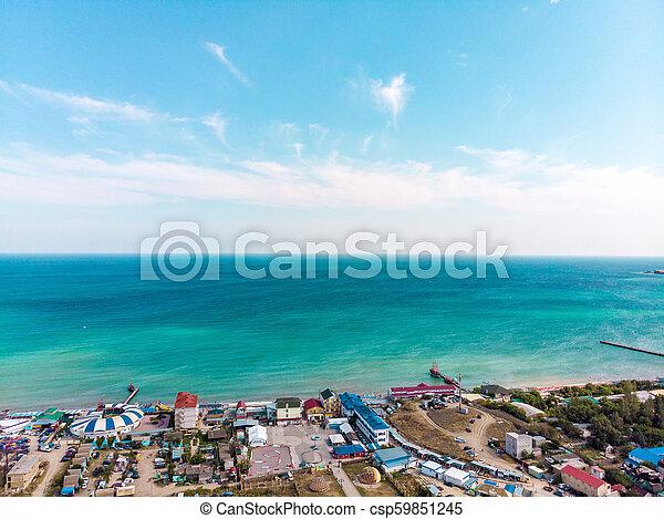 Vista aérea de un pueblo turístico en la costa. - csp59851245