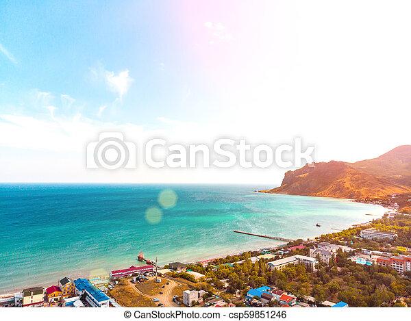 Vista aérea de un pueblo turístico en la costa. - csp59851246