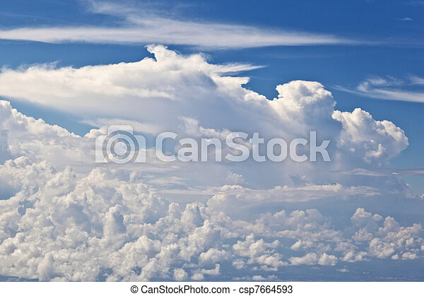 puffy white cloud with blue sky - csp7664593