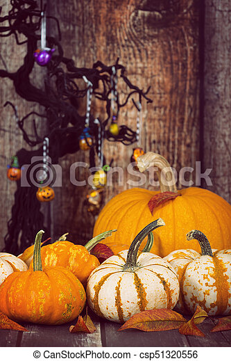Pumpkin Display With Autumn Leaves Against Rustic Halloween Background