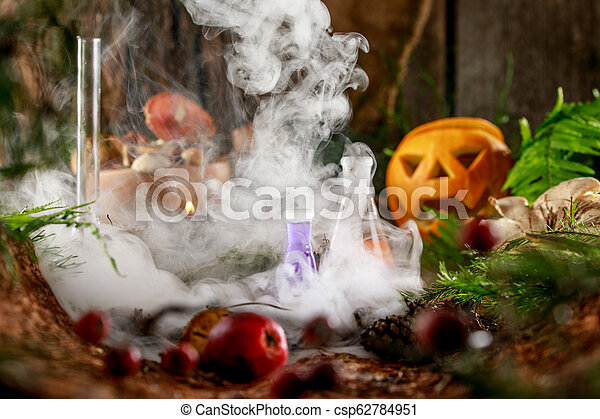 Pumpkin Jack for Halloween and the gifts of the forest on a wooden background. - csp62784951