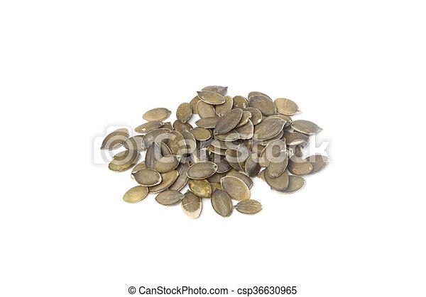 Pumpkin seeds on white background - csp36630965