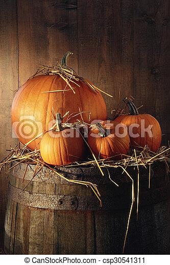 Pumpkins on old barrel - csp30541311