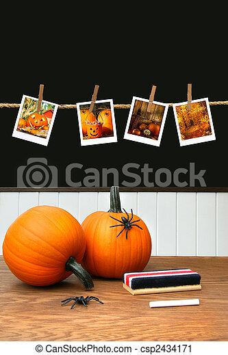 Pumpkins on school desk in classroom - csp2434171