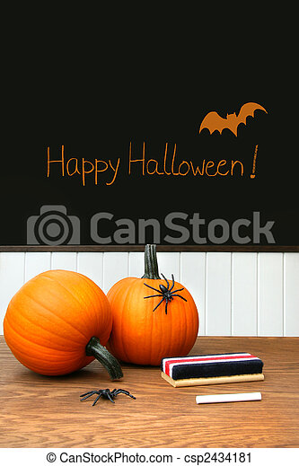 Pumpkins on school desk in classroom - csp2434181