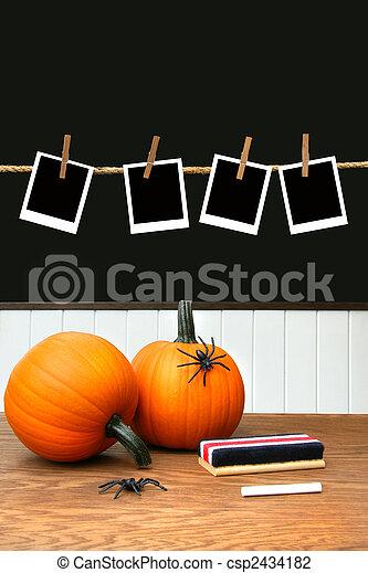 Pumpkins on school desk in classroom - csp2434182