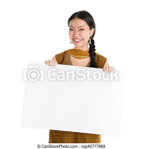 ea0c7c8929 Punjabi girl holding blank white paper card. Portrait of young mixed ...