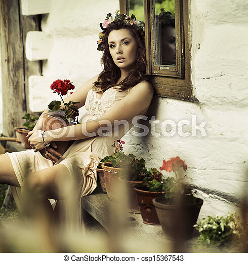 Pure  brunette woman with flowers - csp15367543