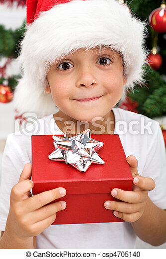 Pure happiness - boy with christmas present - csp4705140