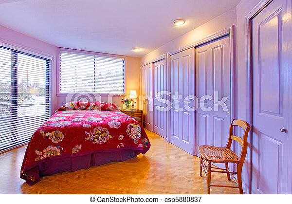 Purple bedroom with pink red bed abd flowers