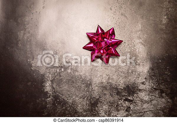 purple bow on a gray background - csp86391914