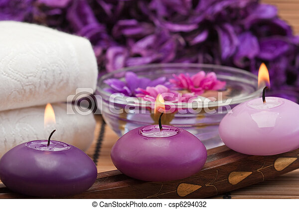 purple candles and flowers in spa setting - csp6294032
