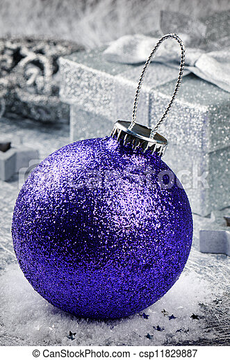 Purple Christmas bauble on silver background - csp11829887