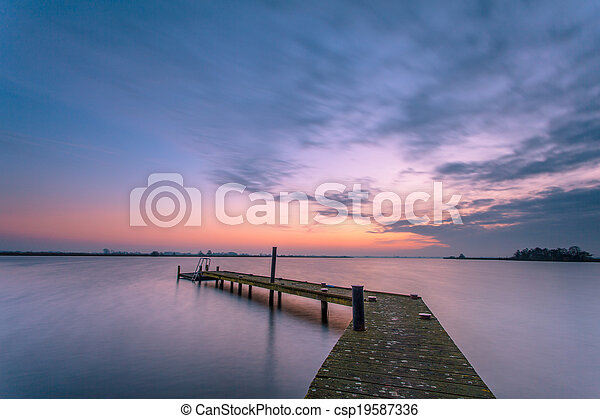 Purple dusk over a tranquil lake - csp19587336