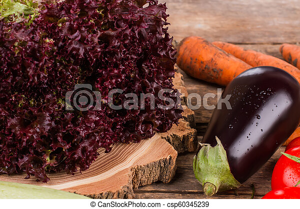 Purple lettuce, eggplant and other vegetables. - csp60345239