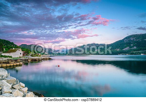 Purple sunset at Jorpeland - csp37889412
