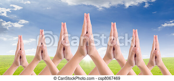 put hands together in salute - csp8067469