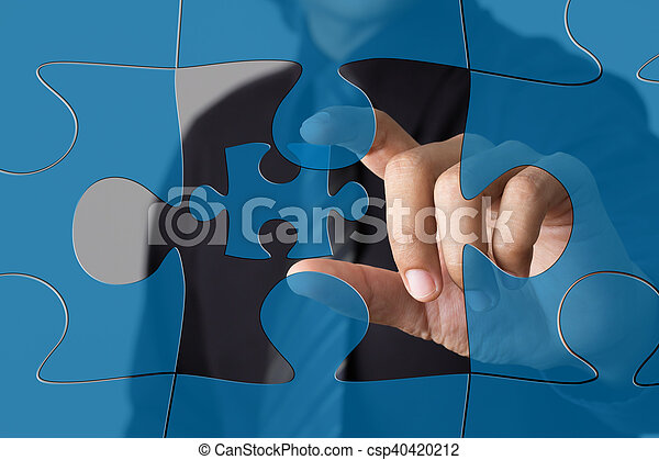 puzzle piece coming down into it s place - csp40420212