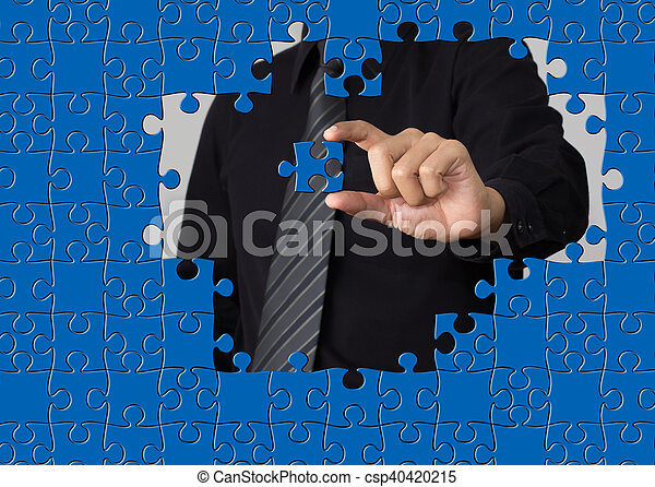 puzzle piece coming down into it s place - csp40420215