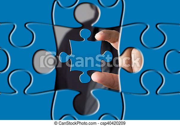 puzzle piece coming down into it s place - csp40420209