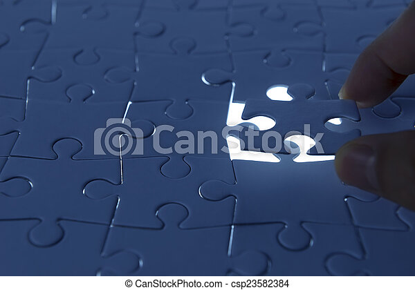 puzzle piece coming down into it's - csp23582384
