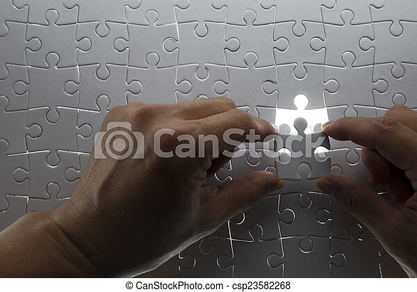 puzzle piece coming down into it's - csp23582268