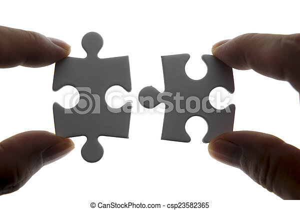 puzzle piece coming down into it's - csp23582365